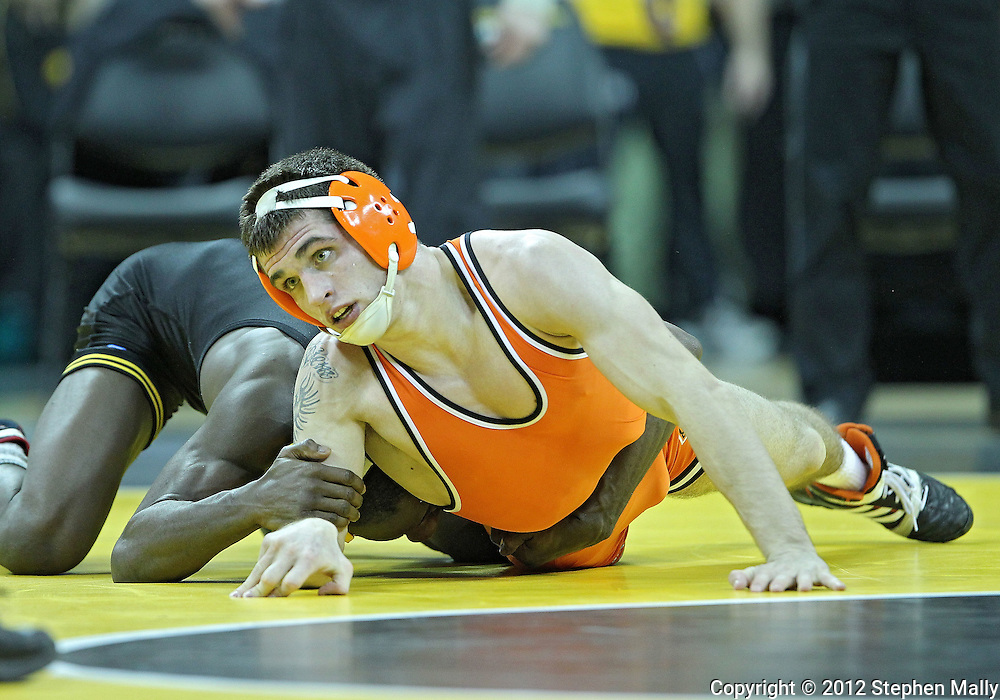 January 07, 2011: Iowa's Montell Marion tries to turn Oklahoma State's Josh Kindig during the 141-pound bout in the NCAA wrestling dual between the Oklahoma State Cowboys and the Iowa Hawkeyes at Carver-Hawkeye Arena in Iowa City, Iowa on Saturday, January 7, 2012. Marion won 9-7.