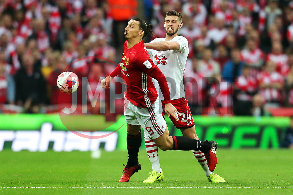 Jack Stephens of Southampton challenges Zlatan Ibrahimovic of Manchester United - Mandatory by-line: Matt McNulty/JMP - 26/02/2017 - FOOTBALL - Wembley Stadium - London, England - Manchester United v Southampton - EFL Cup Final