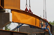 Steel beams that are part of the CTFastrak bridge over Allen Street in New Britain are moved into position on Tuesday. Traffic on Allen Street is being re-routed while the beams are placed. Allen Street is expected to re-open later this week. (Photo by Kevin Bartram)