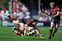 Marcelo Bosch (Saracens) goes flying after receiving a pass - Photo mandatory by-line: Patrick Khachfe/JMP - Tel: Mobile: 07966 386802 13/04/2014 - SPORT - RUGBY UNION - Allianz Park, London - Saracens v Northampton Saints - Aviva Premiership.