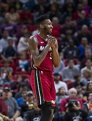January 7, 2018 - Miami, FL, USA - Miami Heat's Derrick Walton, Jr. (5) reacts after a referee says he fouled against Utah Jazz's Alec Burks (10) in the fourth quarter on Sunday, Jan. 7, 2018 at the AmericanAirlines Arena in Miami, Fla. (Credit Image: © Matias J. Ocner/TNS via ZUMA Wire)