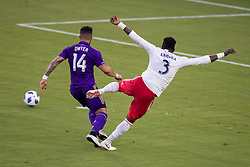August 4, 2018 - Orlando, FL, U.S. - ORLANDO, FL - AUGUST 04: Orlando City forward Dom Dwyer (14) and New England Revolution defender Jalil Anibaba (3) collide while going for the ball during the soccer match between the Orlando City Lions and the New England Revolution on August 4, 2018 at Orlando City Stadium in Orlando FL. (Photo by Joe Petro/Icon Sportswire) (Credit Image: © Joe Petro/Icon SMI via ZUMA Press)
