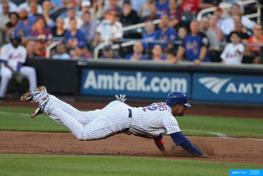 Juan Lagares, New York Mets, dives back to first base during the New York Mets Vs Toronto Blue Jays MLB regular season baseball game at Citi Field, Queens, New York. USA. 16th June 2015. Photo Tim Clayton