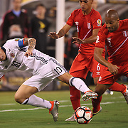 EAST RUTHERFORD, NEW JERSEY - JUNE 17: James Rodriguez #10 of Colombia is challenged by Alberto Rodriguez #2 of Peru during the Colombia Vs Peru Quarterfinal match of the Copa America Centenario USA 2016 Tournament at MetLife Stadium on June 17, 2016 in East Rutherford, New Jersey. (Photo by Tim Clayton/Corbis via Getty Images)