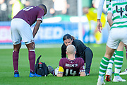 Steven Naismith (#14) of Heart of Midlothian goes down injured during the Betfred League Cup semi-final match between Heart of Midlothian FC and Celtic FC at the BT Murrayfield Stadium, Edinburgh, Scotland on 28 October 2018.