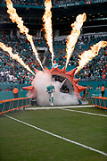 Miami Dolphins quarterback Brock Osweiler (8) runs onto the field in a cloud of white smoke with fire plumes blazing in the background during pregame player introductions before the NFL week 9 regular season football game against the New York Jets on Sunday, Nov. 4, 2018 in Miami Gardens, Fla. The Dolphins won the game 13-6. (©Paul Anthony Spinelli)