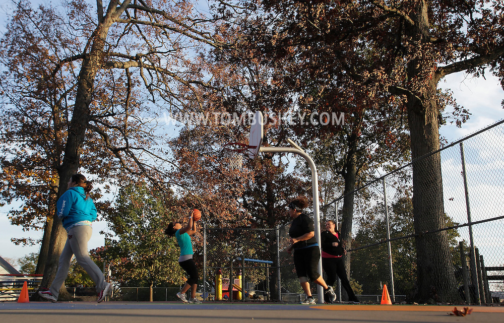 Middletown, New York  - Women exercise on a park basketball court during a Boot Camp class on Oct. 23, 2011.
