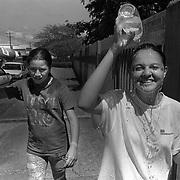 ANGELA JIMENEZ-CR roll 1 February 5, 1999<br />Kattia and her best friend/next door neighbor Faviola roam the streets during a hot summer day.  Both will be fifth graders- Kattia in a public school, Faviola in a Catholic school in Ciudad Quesada.