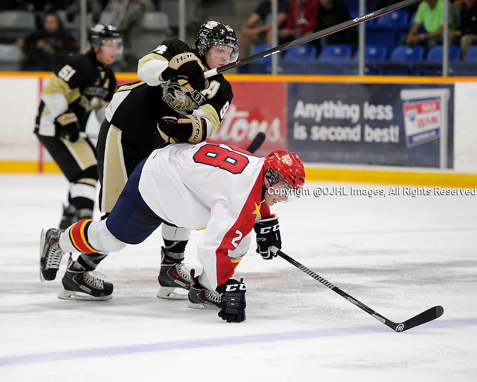 TRENTON, ON - Oct 3, 2014 : Ontario Junior Hockey League game action between Wellington and Trenton, Brady Wiffen #94 of the Trenton Golden Hawks makes the hit on Justin Bean #28 of the Wellington Dukes during the third period<br /> (Photo by Amy Deroche/ OJHL Images)