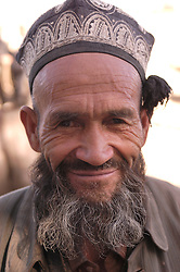Portrait of elderly Uyghur man at famous Sunday market in Kashgar on the ancient Silk Road