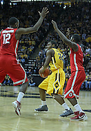 January 07, 2011: Iowa Hawkeyes guard Bryce Cartwright (24) is surrounded by Ohio State Buckeyes forward Sam Thompson (12) and Ohio State Buckeyes guard Shannon Scott (3) during the the NCAA basketball game between the Ohio State Buckeyes and the Iowa Hawkeyes at Carver-Hawkeye Arena in Iowa City, Iowa on Saturday, January 7, 2012.