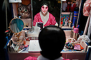 """Actress Nam Fung in her dressing room before the Opera """"The Two Heroic Families"""" performed at the West Kowloon Bamboo theatre."""
