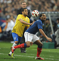 FOOTBALL - FRIENDLY GAME 2010/2011 - FRANCE v BRAZIL - 9/02/2011 - DANIEL ALVES (BRA) / FLORENT MALOUDA (FRA) - PHOTO FRANCK FAUGERE / DPPI