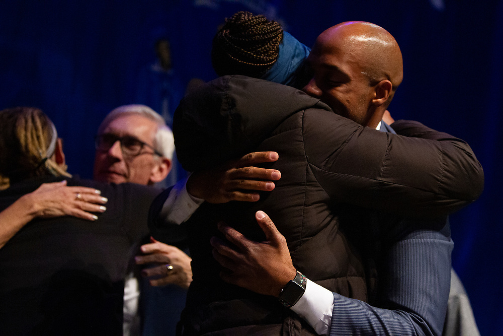 Mandela Barnes hugs his wife during the Election Night watch party at the Orpheum Theater in Madison, Wisconsin, Wednesday, Nov. 7, 2018.