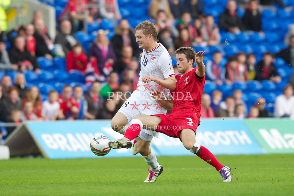 CARDIFF, WALES - Saturday, November 12, 2011: Wales' Adam Matthews in action against Norway's Erik Huseklepp during the international friendly match at the Cardiff City Stadium. (Pic by Vegard Grott/Propaganda)