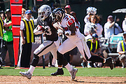 Oakland Raiders running back DeAndre Washington (33) carries the ball against the Atlanta Falcons at Oakland Coliseum in Oakland, Calif., on September 18, 2016. (Stan Olszewski/Special to S.F. Examiner)