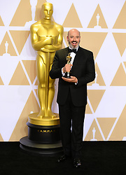 Mark Bridges with his oscar for Best Costume Design in Phantom Thread in the press room at the 90th Academy Awards held at the Dolby Theatre in Hollywood, Los Angeles, USA.