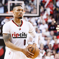 25 April 2016: Portland Trail Blazers guard Damian Lillard (0) looks to pass the ball during the Portland Trail Blazers 98-84 victory over the Los Angeles Clippers, during Game Four of the Western Conference Quarterfinals of the NBA Playoffs at the Moda Center, Portland, Oregon, USA.