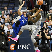 WASHINGTON, D.C. - JANUARY 6:  Georgetown Hoyas center Jessie Govan (15) is fouled by Creighton Bluejays forward Martin Krampelj (15) on January 6, 2018, at the Capital One Arena in Washington, DC.  The Creighton Bluejays defeated the Georgetown Hoyas, 90-66.  (Photo by Mark Goldman/Icon Sportswire)