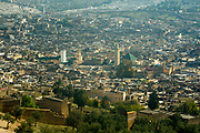 FEZ, MOROCCO - 1st DECEMBER 2016 - Cityscape urban skyline view over the old Fez Medina with the Al-Karaouine Mosque and University and the Zawiya Moulay Idriss II in view, Middle Atlas Mountains, Morocco.