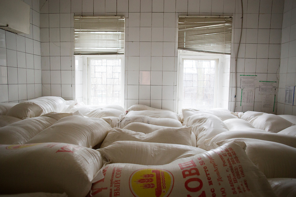 Sacks of flour from a humanitarian aid conference are stacked in all available spaces at Zasyadko Mine on March 7, 2015 in Donetsk, Ukraine.