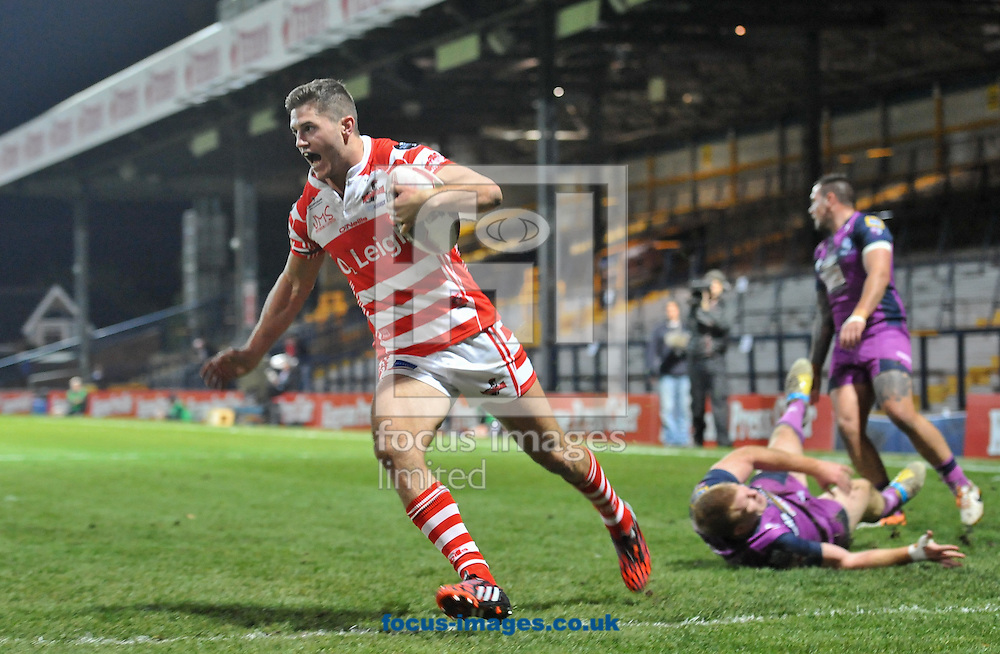 Tom Armstrong of Leigh Centurions gets away from Ian Hardman of Featherstone Rovers as he races in to score during the Kingstone Press Championship Final at Headingley Carnegie Stadium, Leeds<br /> Picture by Richard Land/Focus Images Ltd +44 7713 507003<br /> 05/10/2014