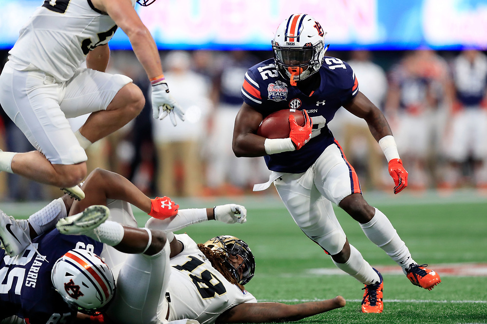 Auburn Tigers wide receiver Eli Stove (12) runs the ball during the 2018 Chick-fil-A Peach Bowl NCAA football game against the UCF Knights on Monday, January 1, 2018 in Atlanta. (Paul Abell / Abell Images for the Chick-fil-A Peach Bowl)