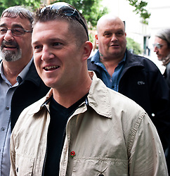 """DL leaders Tommy Robinson and Kevin Carrol appear in court,<br /> English Defence League, leaders Kevin Carroll (not in frame) and Tommy Robinson appear at the Westminster Magistrates' Court. Robinson, whose real name is Stephen Yaxley-Lennon, and Carroll are accused of obstructing police by trying to defy a ban on marching to the scene of Fusilier Lee Rigby's murder via the East London Mosque on June 29, 2013, London, United Kingdom. Wednesday, 11th September 2013. Picture by Piero Cruciatti / i-Images<br /> <br /> File Photo - EDL leaders Tommy Robinson & Kevin Carroll quit group. English Defence League leader and founder Tommy Robinson has left the group, saying he has concerns over the """"dangers of far-right extremism"""". Mr Robinson's co-leader, Kevin Carroll, has also opted to leave. Picture by Piero Cruciatti / i-Images. Filed Tuesday 8 October, 2013"""