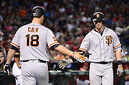 May 15, 2016; Phoenix, AZ, USA; San Francisco Giants catcher Trevor Brown (14) is congratulated by starting pitcher Matt Cain (18) after hitting a solo home run in the third inning against the Arizona Diamondbacks at Chase Field. Mandatory Credit: Jennifer Stewart-USA TODAY Sports