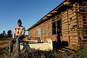 Makhosonte Sonjani, Vice Chair of the Hogsback Residents Association. He was born on the adjacent plot of land to Bold Point. Frustrated with the delays in he has begun to build his own home and a guesthouse, which he intends to run as a bed and breakfast<br /> <br /> During Apartheid the workers in the mountain retreat town of Hogsback were not allowed to own their own property. They had to reside on their employer&rsquo;s properties or commute from the Ciskei homeland in the valley below.<br /> <br /> Since the early 1990&rsquo;s the workers in Hogsback have been trying to get the go ahead for a low cost housing development but continue to face delays and legal challenges. The Legal Resources Centre is representing the Hogsback workers in negotiations to find a suitable site for the low cost housing development.<br /> <br /> &copy;Zute &amp; Demelza Lightfoot / Legal Resources Centre