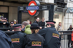 London, UK. 14 October, 2019. Police officers arrest a man who assaulted a climate activist from Extinction Rebellion in King William Street on the eighth day of International Rebellion protests across London. Today's activities were concentrated around the  City of London's finance district.