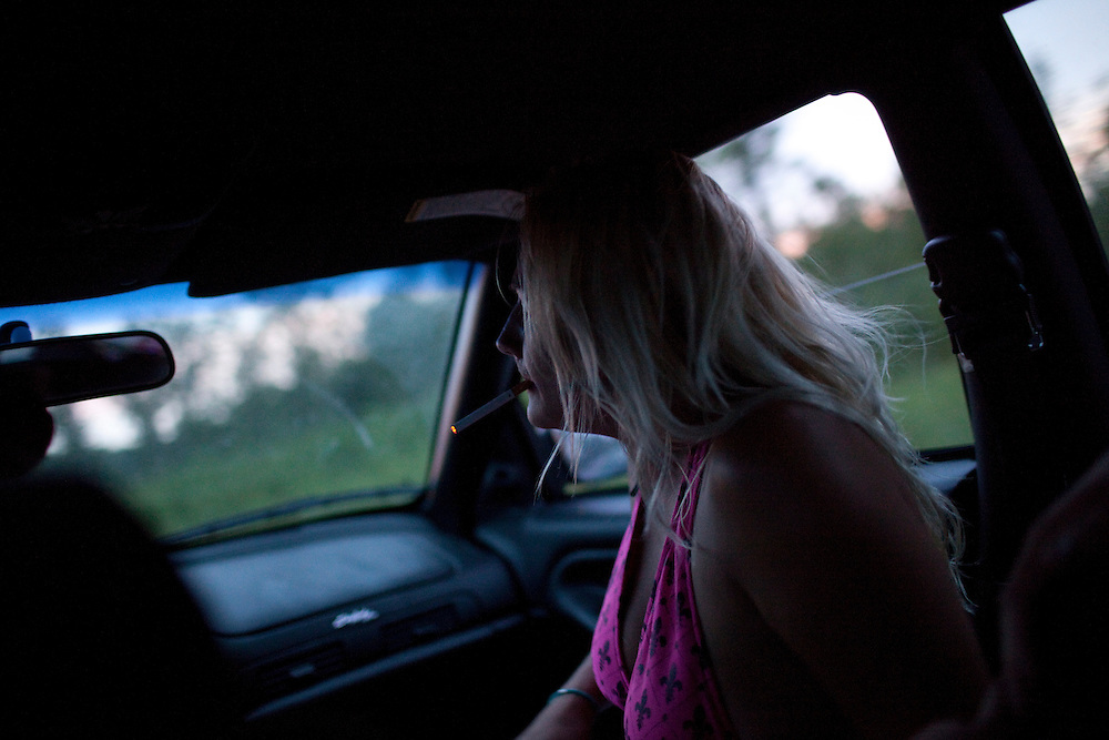A woman rides home from a bar and a day at the beach with friends in Lockport, NY, on Thursday, July 30, 2009.