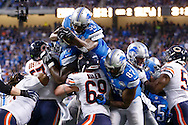 Detroit Lions running back Joique Bell (35) dives into the end zone for a touchdown against the Chicago Bears during an NFL football game at Ford Field in Detroit, Thursday, Nov. 27, 2014. (AP Photo/Rick Osentoski)