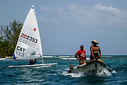World Sailing Emerging Nations Program - Boca Chica Sailing Club, Santo Domingo 08/19/2017 - DAY 1- Jessee Jackson at training next to a local transport boat