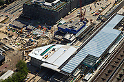 Nederland, Zuid-Holland, Rotterdam, 23-05-2011; Groothandelsgebouw (r) en nieuwbouw Centraal Station met nieuwe overkapping voor HSL. Groothandelsgebouw (t) and new construction railwaystation with new roof for HST. ..luchtfoto (toeslag), aerial photo (additional fee required).copyright foto/photo Siebe Swart