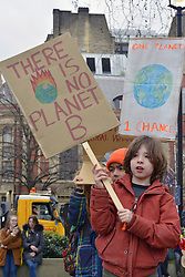 School pupils call for radical climate action in UK-wide strike in which thousands of young people from around the country took part - more than 15,000 marched from  Parliament Square to Downing Street, UK. 15 March 2019
