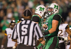 Oct 9, 2015; Huntington, WV, USA; Marshall Thundering Herd tight end Ryan Yurachek (85) celebrates with quarterback Chase Litton after receiving a touchdown pass during the second quarter against the Southern Miss Golden Eagles at Joan C. Edwards Stadium. Mandatory Credit: Ben Queen-USA TODAY Sports