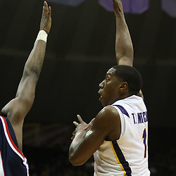 14 February 2009: LSU forward Tasmin Mitchell (1) shoots over Malcolm White (21) of Ole Miss during a NCAA basketball game between SEC rivals the Ole Miss Rebels and the LSU Tigers at the Pete Maravich Assembly Center in Baton Rouge, LA.