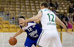 Mensud Julevic of Elektra vs Goran Jagodnik of Olimpija during basketball match between KK Union Olimpija and KK Elektra Sostanj in 6th Round of Telemach League for Slovenian National Champion 2011/12, on April 12, 2012, in Hala Tivoli, Ljubljana, Slovenia. (Photo by Vid Ponikvar / Sportida.com)