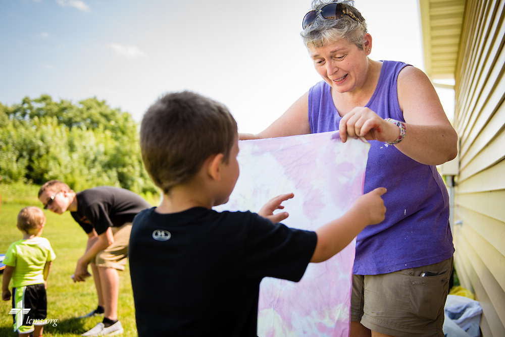 Xavier Shade receives a tie dye bandana during the grand opening of the Iowa Life Care (LC) Clinic on Saturday, Aug. 15, 2015, in Creston, Iowa. The clinic is a former Planned Parenthood facility. LCMS Communications/Erik M. Lunsford
