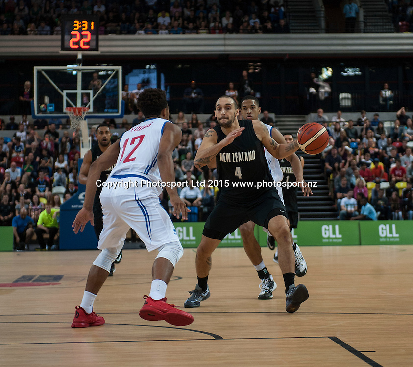 25.07.2015. London England. Basketball test match. Great Britain versus New Zealand.  Tall Blacks Guard Lindsay Tait [#4] in action with GBR Alex Young [#12].