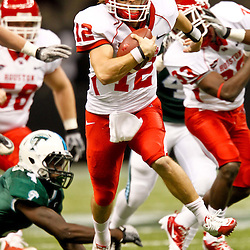 November 10, 2011; New Orleans, LA, USA; Houston Cougars quarterback Cotton Turner (12) runs for a touchdown against the Tulane Green Wave during the fourth quarter at the Mercedes-Benz Superdome.  Houston defeated Tulane 73-17. Mandatory Credit: Derick E. Hingle-US PRESSWIRE