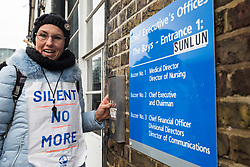 London, UK. 29 October, 2019. An outsourced worker belonging to the United Voices of the World (UVW) trade union protests outside the office of the Chief Executive of Imperial College Healthcare NHS Trust Professor Tim Orchard at St Mary's Hospital Paddington. Around 200 migrant cleaners, porters and caterers outsourced via Sodexo, one of the world's largest multinational corporations, are striking for equal pay, conditions and treatment with broadly equivalent NHS colleagues who are paid £6,000-10,000 p.a. more and have scheduled 12 days of strike action.