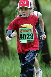 "(Kingston, Ontario---16/05/09) ""Liam Walsh running in the kids race at the 2009 Salomon 5 Peaks Trail Running series Race held in Kingston, Ontario as part of the Eastern Ontario/Quebec division. ""  Copyright photograph Sean Burges / Mundo Sport Images, 2009. www.mundosportimages.com / www.msievents.com."