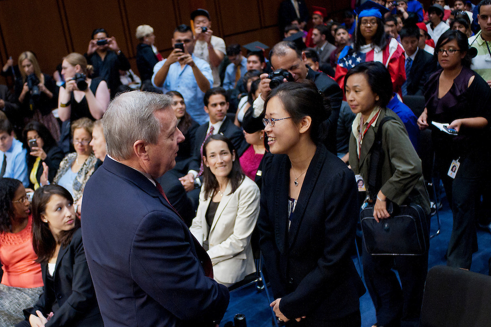 "Senator DICK DURBIN (D-IL) greets TEREZA LEE before a Senate Judiciary Committee hearing on ""The DREAM (Development, Relief and Education for Alien Minors) Act."" Ten years ago LEE had been accepted into several of the country's most prestigious music conservatories. But her parents had brought her to the United States when she was two, and she was undocumented. That spurred DURBIN to begin work on the DREAM Act ten years ago."