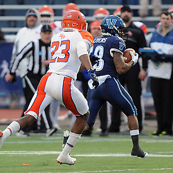 TOM KELLY IV &mdash; DAILY TIMES<br /> Villanova's Poppy Livers (18) catches a pass in front of SHS's Eric Agbaroji (23) during the Sam Houston State University at Villanova University NCAA FCS Division 1 - AA quarterfinal game at Villanova Stadium.