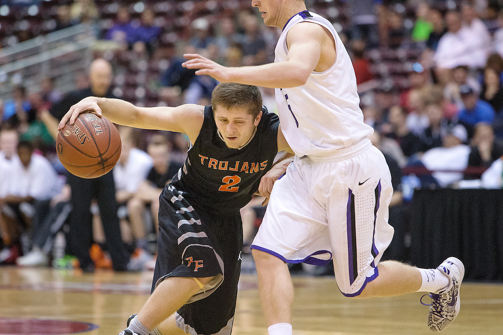 GABE GREEN/Press<br /> <br /> Nick Hall, a Post Falls guard, makes contact with a Rocky Mountain player as he drives the ball toward the hoop during the 5A state tournament Thursday.