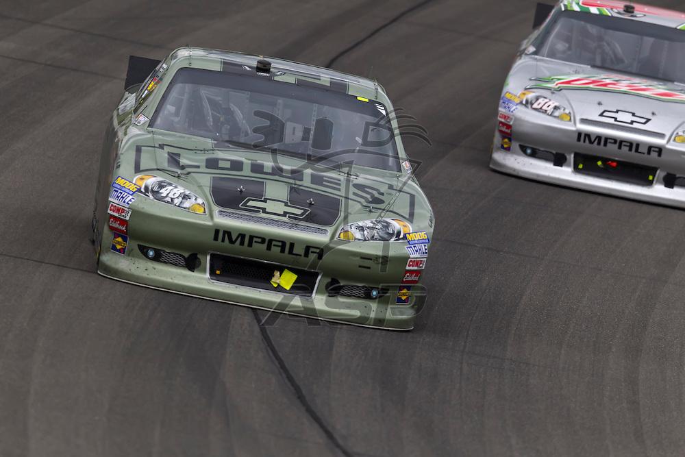 KANSAS CITY, KS - APR 22, 2012:  Jimmie Johnson (48) races during the STP 400 at the Kansas Speedway in Kansas City, KS.