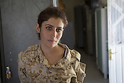 Sulaymaniyah, Iraq - <br /> <br /> Female Fighters of The Peshmerga<br /> As ISIS has swept across northern Iraq, they have become known for their atrocities towards women. However, there's a group of women that aren't preparing to flee ISIS but instead are preparing to meet them with their AK-47s. The 2nd Peshmerga, are a battalion of Kurdish fighters &sbquo;&Auml;&igrave; and they just happen to be an all-female soldiers. They're front line troops, some of whom have been fighting for years, and they are eager to face ISIS. Dressed in army fatigues and armed with rifles, they are ready to lay down their lives to protect the Kurdish homeland against the threat of ISIS. They carry out training exercises and look no different from other Kurdish soldiers - except for a hint of makeup on some faces and long hair escaping from their caps. The 2nd Battalion consists of 550 mothers, sisters and daughters and was formed in 1996. Over the past month, they have moved into disputed areas abandoned by Iraqi security forces during the Isis advance. They have also recently seized control of oil production facilities at Bai Hassan and Kirkuk - the female Peshmerga will now be part of a mission to secure the city and its surrounding oil fields.<br /> <br /> A woman Peshmerga in her living quarters after a military exercise<br /> &copy;Excluisvepix Media