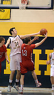 NEW HOPE, PA. - JANUARY 23: New Hope Solebury's Max Wagner #34 battles for a rebound with Holy Ghost Prep's Tim Brandt #13 in the first quarter at New Hope Solebury High School January 23, 2015 in New Hope, Pennsylvania. (Photo by William Thomas Cain/Cain Images)